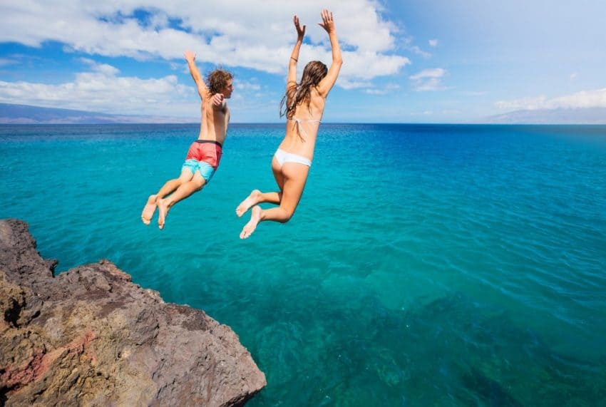 Cuba Vacation Package - Friends Jumping from a Cliff