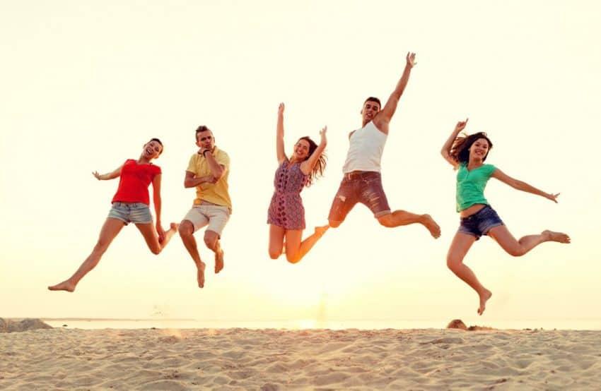 Cuba Vacation Package - Friends Jumping in a Cuban Beach