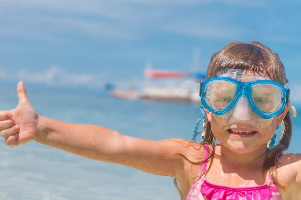 Family trips to Cuba - Happy child in a Cuban beach